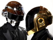 FILE - In this April 17, 2013 file photo, Thomas Bangalter, left, and Guy-Manuel de Homem-Christo, from the music group, Daft Punk, pose for a portrait in Los Angeles. The Grammy-winning French act have announced their break up.