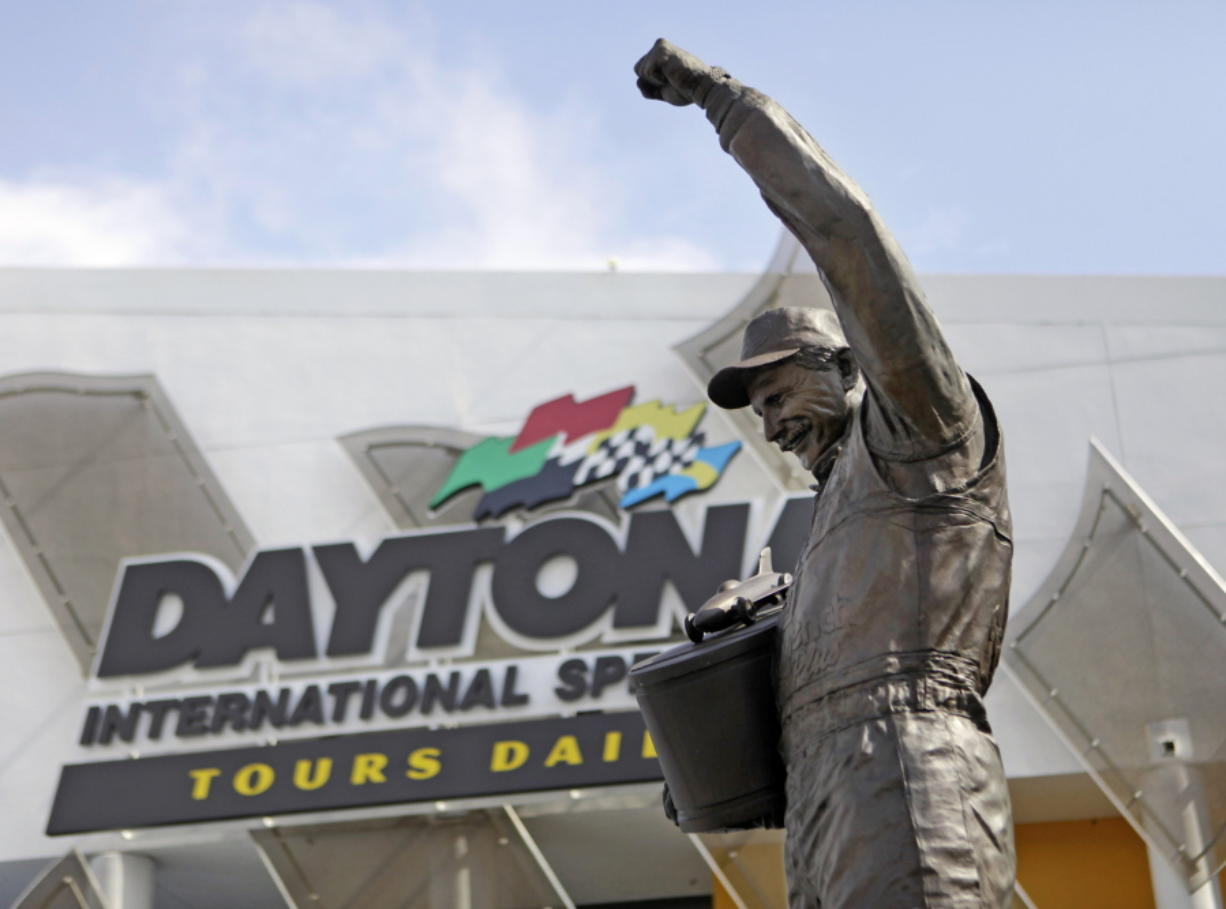 FILE - In this Feb. 16, 2011, file photo, a statue of Dale Earnhardt rises above an entrance at Daytona International Speedway in Daytona Beach, Fla. On the cusp of a national popularity explosion, NASCAR never stopped after the deaths of Adam Petty, Kenny Irwin Jr. and Tony Roper. But losing Earnhardt forced the stock car series to confront safety issues it had been slow to even acknowledge, let alone address. The dramatic upgrades have saved multiple lives -- NASCAR has not suffered a racing death in its three national series since -- and are the hallmark of Earnhardt's legacy.
