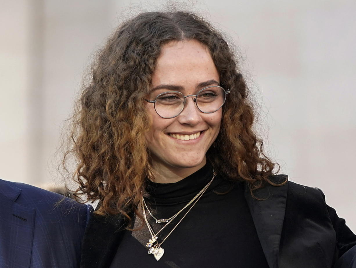 FILE -Ella Emhoff appears at a rally for her stepmother Sen. Kamala Harris, announcing Harris' presidential campaign in Oakland, Calif., Sunday, Jan. 27, 2019. The designers at Proenza Schouler dressed Ella Emhoff in a couple of coats (plus a pantsuit) for her modeling debut in their new collection, unveiled Thursday for New York Fashion Week. Designers Lazaro Hernandez and Jack McCollough said the fashion world took quick notice when 21-year-old Emhoff appeared at the inauguration in January, dressed in a quirky Miu Miu coat with bejeweled shoulders along with a starchy white collar.