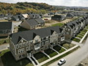 In this image taken with a drone, new townhouses are shown in Valencia, Pa., on Thursday, Oct. 15, 2020. Sales of new homes fell by 3.5% in September to a seasonally-adjusted annual rate of 959,000 million units. The Commerce Department said Monday, Oct. 26, 2020, that despite the modest decrease, sales of new homes are up 32.1% from a year earlier, as the housing market remains strong despite the pandemic.