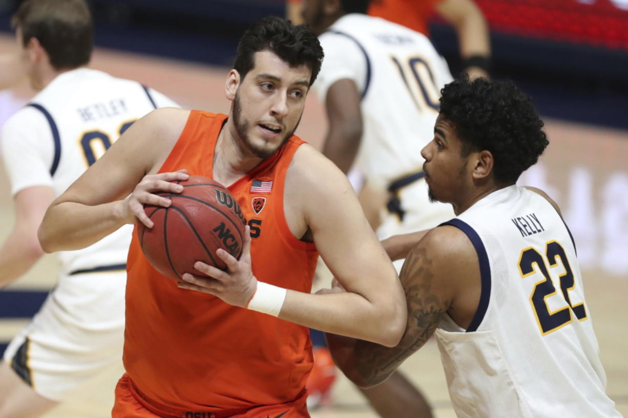 Oregon State center Roman Silva drives to the basket against California forward Andre Kelly during the first half of an NCAA college basketball game in Berkeley, Calif., Thursday, Feb. 25, 2021.