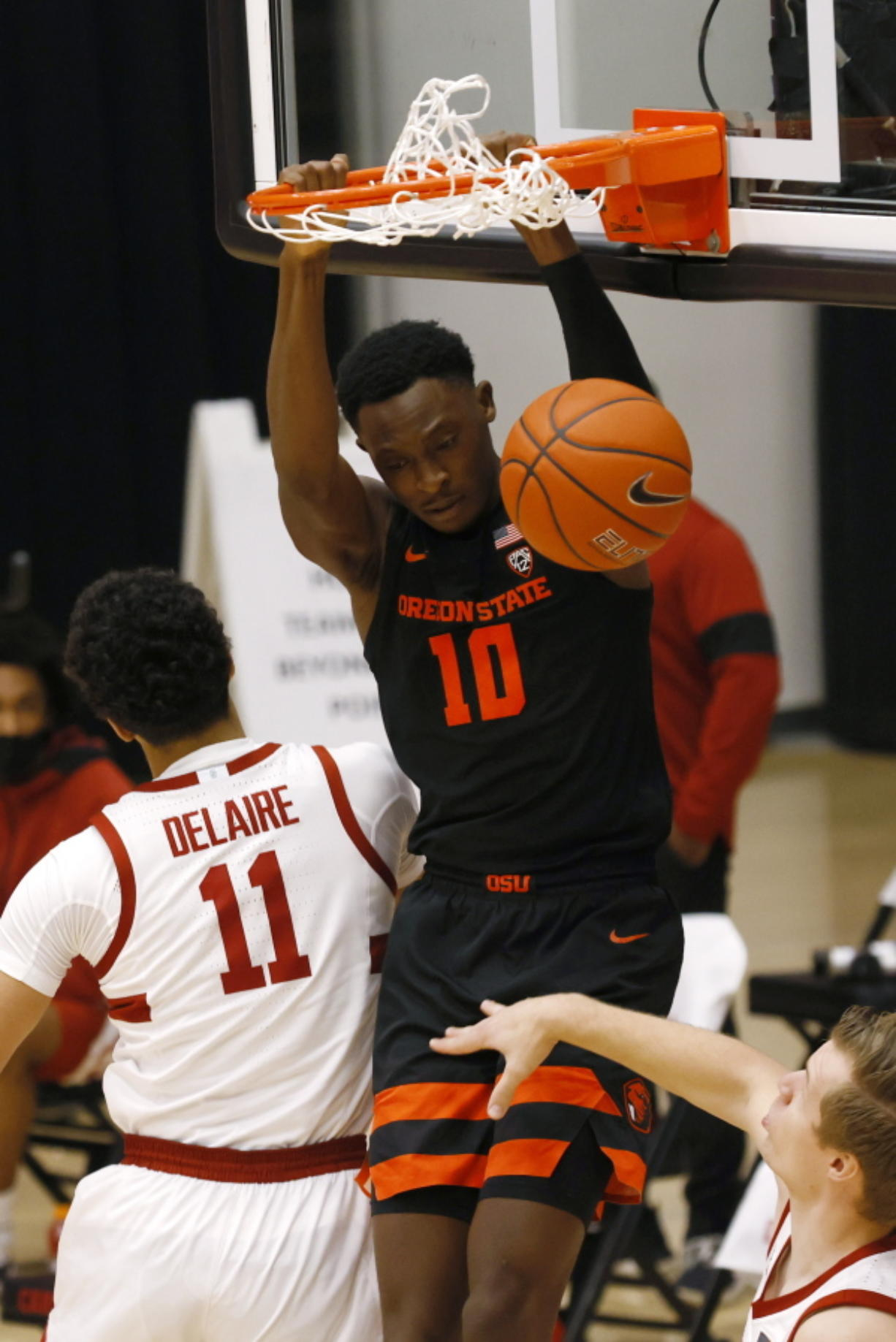 Oregon State forward Warith Alatishe (10) dunks in front of Stanford forward Jaiden Delaire (11) during the first half of an NCAA college basketball game in Stanford, Calif., Saturday, Feb. 27, 2021.