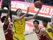 Oregon guard Chris Duarte (5) shoots in front of Stanford forwards Ziaire Williams (3) and Jaiden Delaire (11) during the first half of an NCAA college basketball game in Stanford, Calif., Thursday, Feb. 25, 2021.