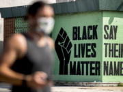 FILE - In this July 13, 2020, file photo, a black lives matter mural is visible in the Shaw neighborhood in Washington. The Black Lives Matter Global Network Foundation, which grew out of the creation of the Black Lives Matter movement, is formally expanding a $3 million financial relief fund that it quietly launched in February 2021, to help people struggling to make ends meet during the ongoing coronavirus pandemic.