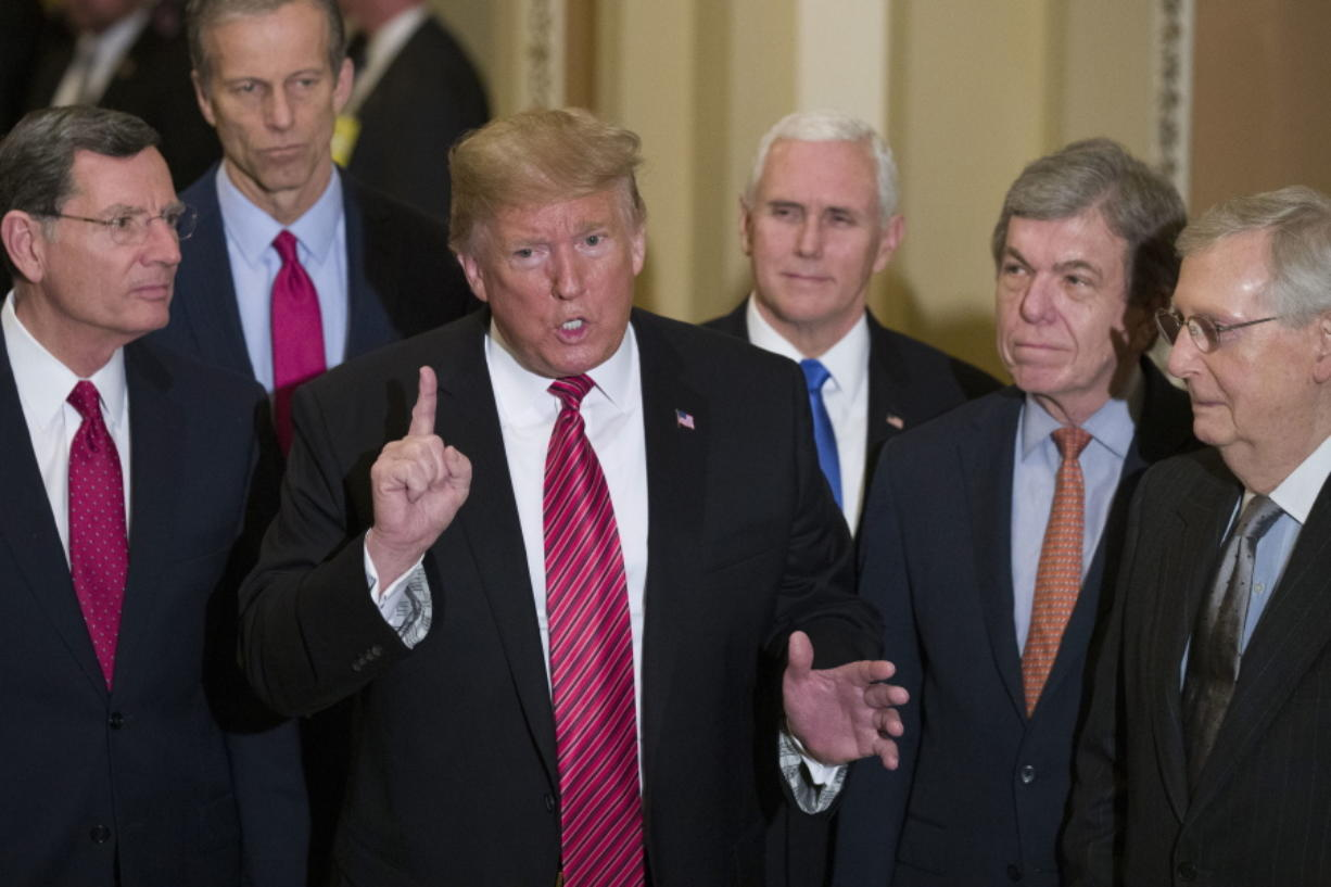 FILE - In this Wednesday, Jan. 9, 2019 file photo, Sen. John Barrasso, R-Wyo., left, and Sen. John Thune, R-S.D., stand with President Donald Trump, Vice President Mike Pence, Sen. Roy Blunt, R-Mo., and Senate Majority Leader Mitch McConnell of Ky., as Trump speaks while departing after a Senate Republican Policy luncheon, on Capitol Hill in Washington. The Republican Party still belongs to Donald Trump. The GOP privately flirted with purging the norm-shattering former president after he incited a deadly riot at the U.S. Capitol last month. But in the end, only seven of 50 Senate Republicans voted to convict Trump in his historic second impeachment trial on Saturday, Feb. 13, 2021.
