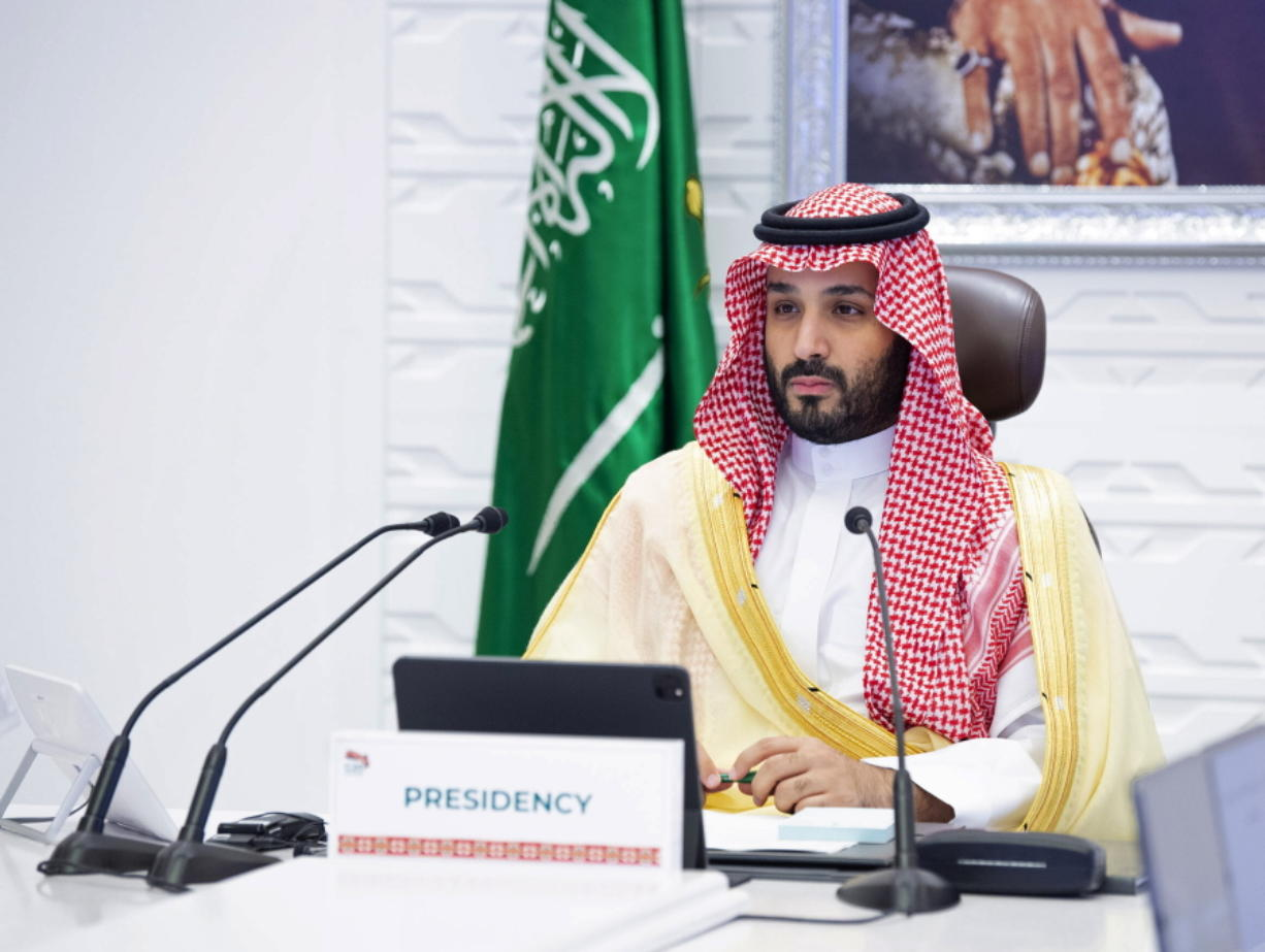 """FILE - In this Sunday, Nov. 22, 2020, file photo, Saudi Arabia's Crown Prince Mohammed bin Salman attends a virtual G-20 summit held over video conferencing, in Riyadh, Saudi Arabia. Saudi Arabia's royal court says Crown Prince Mohammed bin Salman underwent a """"successful surgery"""" for appendicitis on Wednesday, Feb. 24, 2021, and left the hospital soon after the operation. The 35-year-old Prince Mohammed had laparoscopic surgery at the King Faisal Specialist Hospital in the Saudi capital of Riyadh in the morning."""