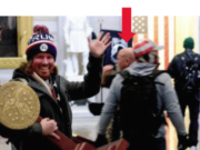 A photo included in federal charging documents shows Battle Ground resident Jeffrey Grace, 61, in the background of a photo of a man carrying U.S. House Speaker Nancy Pelosi's lectern during the Jan. 6 riot at the U.S. Capitol. Grace was arrested by federal authorities Thursday on suspicion of one count of unauthorized entering or remaining in any restricted building or grounds. (U.S.