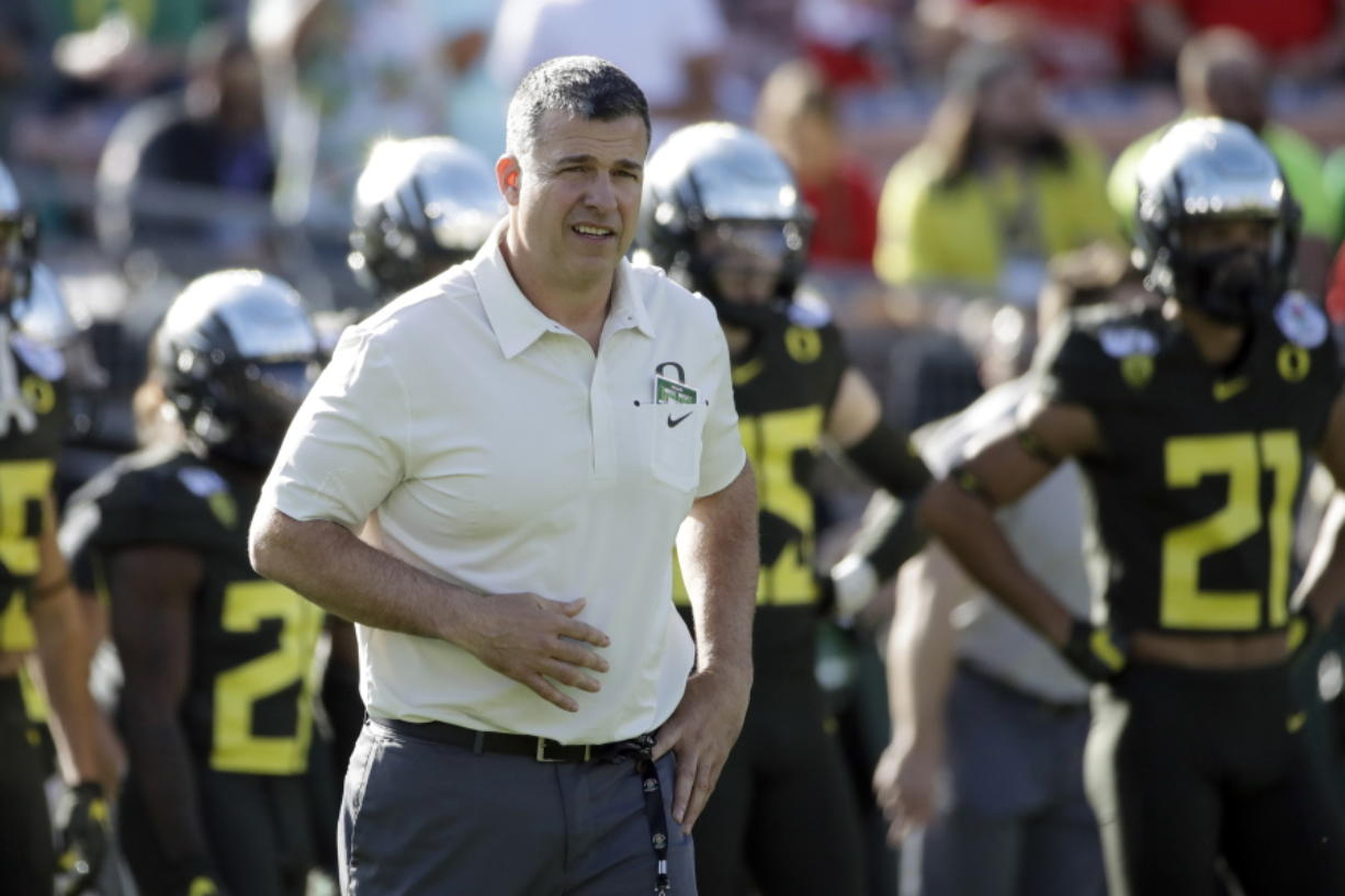 FILE - Oregon head coach Mario Cristobal watches during warm ups before the Rose Bowl NCAA college football game against Wisconsin, in Pasadena, Calif., in this Wednesday, Jan. 1, 2020, file photo. The National Signing Day period begins Wednesday, Feb. 3, 2021.