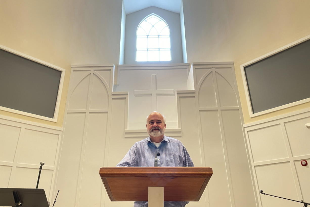 FILE - In this Thursday, Feb. 18, 2021 file photo, Pastor Jim Conrad stands in the Towne View Baptist Church in Kennesaw, Ga. In its 2021 meeting, the Southern Baptist Convention's executive committee voted to oust the church for allowing LGBTQ people to become members of its congregation.