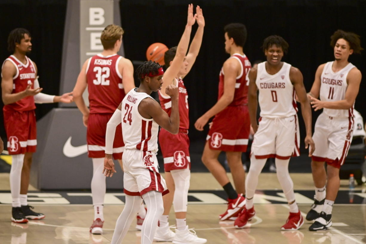 Washington State guard Noah Williams (24) reacts after scoring a basket while being fouled by Stanford guard Michael O'Connell (5) during the first half of an NCAA college basketball game, Saturday, Feb. 20, 2021, in Pullman, Wash.