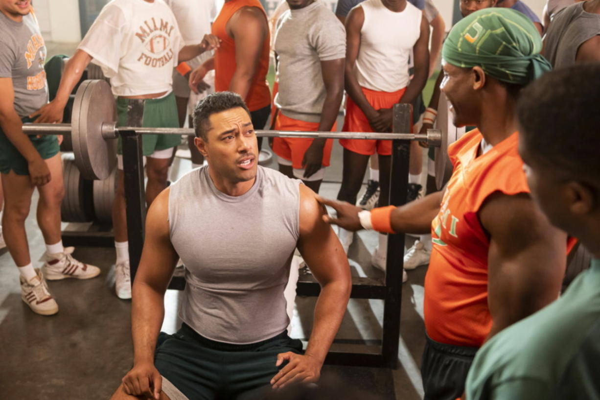 """This image released by NBC shows Uli Latukefu as Dwayne Johnson in a scene from """"Young Rock,"""" debuting on Feb. 16."""