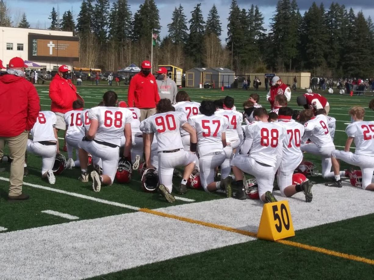 Coach Aaron Gehring talks to his players after Castle Rock's win over Goldendale on Saturday, Feb.