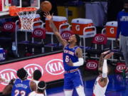 New York Knicks guard Elfrid Payton (6) goes to the basket past Portland Trail Blazers guard Damian Lillard (0) during the first half of an NBA basketball game, Saturday, Feb. 6, 2021, in New York.