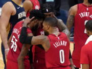 Portland Trail Blazers guard Damian Lillard (0) celebrates with forward Derrick Jones Jr. (55) and forward Robert Covington after the team's victory over the New Orleans Pelicans in an NBA basketball game in New Orleans, Wednesday, Feb. 17, 2021.