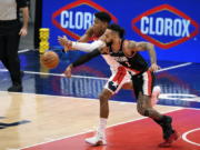 Washington Wizards forward Rui Hachimura, back, of Japan, battles for the ball against Portland Trail Blazers guard Gary Trent Jr. (2) during the first half of an NBA basketball game, Tuesday, Feb. 2, 2021, in Washington.