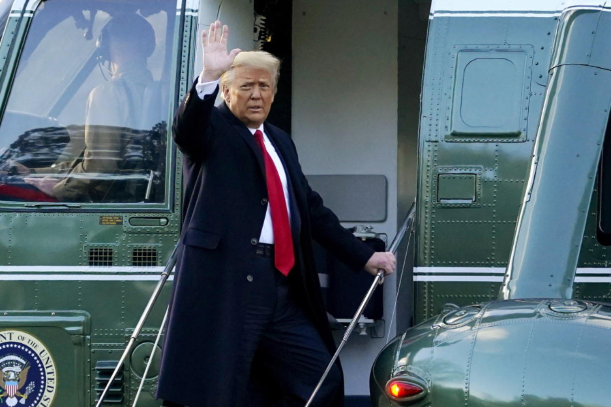 FILE - In this Wednesday, Jan. 20, 2021, file photo, President Donald Trump waves as he boards Marine One on the South Lawn of the White House, in Washington, en route to his Mar-a-Lago Florida Resort. Former President Trump has named two lawyers to his impeachment defense team, one day after it was revealed that the former president had parted ways with an earlier set of attorneys.