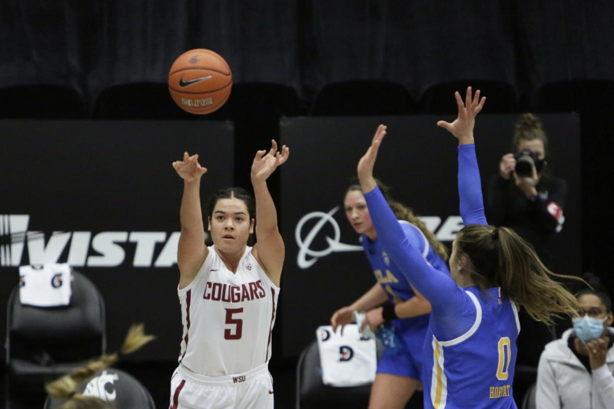 Washington State guard Charlisse Leger-Walker (5) shoots next to UCLA guard Chantel Horvat (0) during the first half of an NCAA college basketball game in Pullman, Wash., Friday, Feb. 5, 2021.