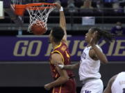 Southern California forward Isaiah Mobley dunks next to Washington forward Hameir Wright during the first half of an NCAA college basketball game Thursday, Feb. 11, 2021, in Seattle. (AP Photo/Ted S.