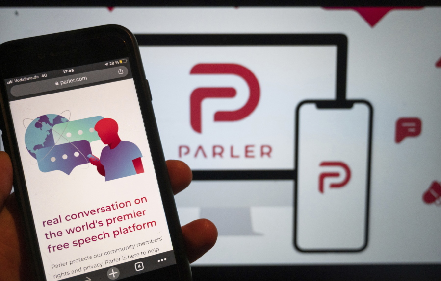 FILE - In this Jan. 10, 2021, file photo, the website of the social media platform Parler is displayed in Berlin. John Matze said Wednesday, Feb. 3, 2021 he has been fired as CEO of Parler, which was among social media services used to plan the Jan. 6 attack on the U.S. Capitol by supporters of then-President Donald Trump.