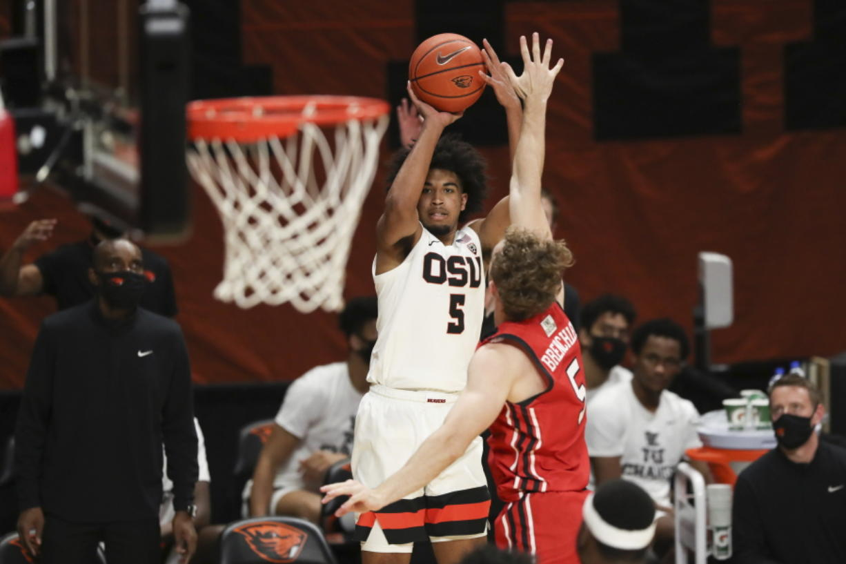 Oregon State's Ethan Thompson (5) shoots over Utah's Jaxon Brenchley (5) during the second half of an NCAA college basketball game in Corvallis, Ore., Thursday, Feb. 18, 2021.