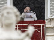 Pope Francis delivers his blessing from his studio window overlooking St. Peter's Square, at the Vatican, Sunday, Feb. 7, 2021.