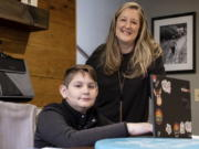 Kelli Rivera is photographed with her son Tate, 11 at their home in Roswell, Ga., Friday, Feb. 12, 2021.  Rivera is hoping a voucher bill passes that will help pay for her to move her son out of a public Cobb County school and into a private school.