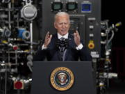 FILE - In this Feb. 19, 2021, file photo President Joe Biden speaks after a tour of a Pfizer manufacturing site in Portage, Mich.
