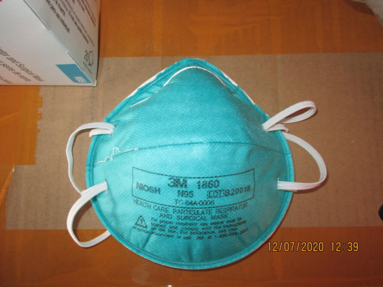 This December 2020 image provided by U.S. Immigration and Customs Enforcement (ICE) shows a counterfeit N95 surgical mask that was seized by ICE and U.S. Customs and Border Protection. Federal investigators are probing a massive counterfeit N95 mask operation sold in at least five states to hospitals, medical facilities, and government agencies and expect the number to rise significantly in coming weeks. The fake 3M masks are at best a copyright violations and at worst unsafe fakes that put unknowing health care workers at grave risk for coronavirus. And they are becoming increasingly difficult to spot.