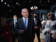 Israeli Prime Minister Benjamin Netanyahu meets Israeli actress Carmit Mesilati Kaplan, right, during a visit to the Khan theater ahead of the re-opening of the culture sector, in Jerusalem on Tuesday, Feb.  23, 2021.