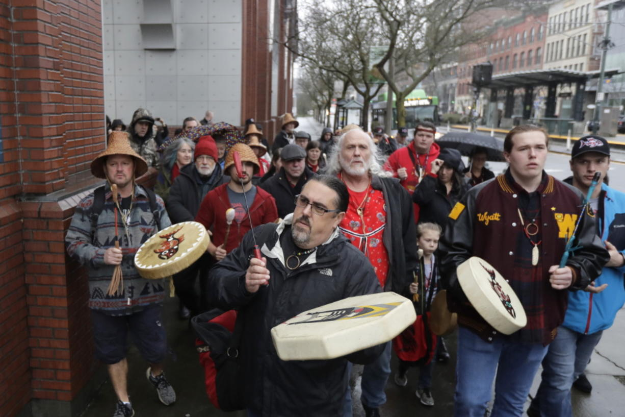 Tony A. (Naschio) Johnson, center, chairman of the Chinook Indian Nation, leads tribal members and supporters as they march Jan. 6, 2020, to the federal courthouse in Tacoma, as they continue their efforts to regain federal recognition. As COVID-19 disproportionately affects Native American communities, many tribal leaders say the pandemic poses particular risks to tribes without federal recognition.