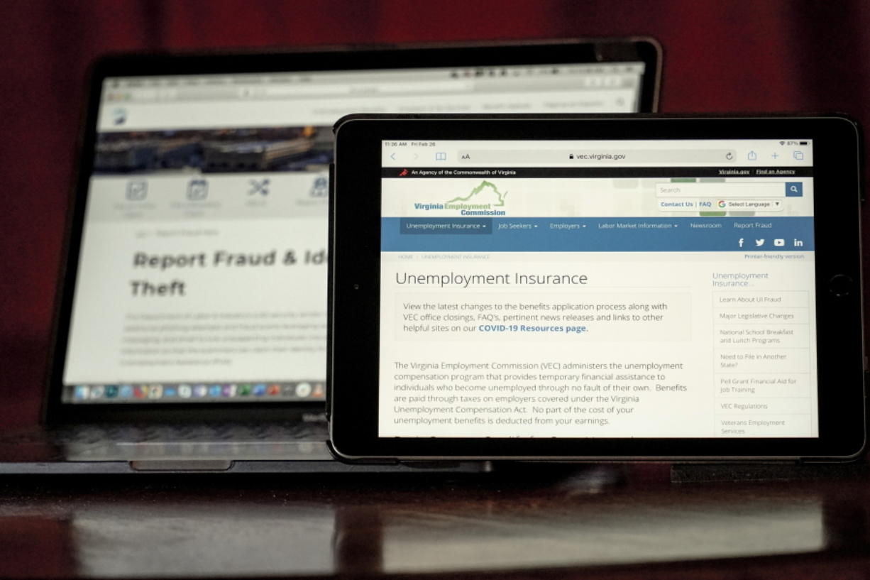 Web pages used to show information for collecting unemployment insurance in Virginia, right, and reporting fraud and identity theft in Pennsylvania, are displayed on the respective state web pages, Friday, Feb. 26, 2021, in Zelienople, Pa. Massive fraud in the nation's unemployment system is raising alarms even as President Joe Biden and Congress prepare to pour hundreds of billions more into expanded benefits for those left jobless by the coronavirus pandemic.
