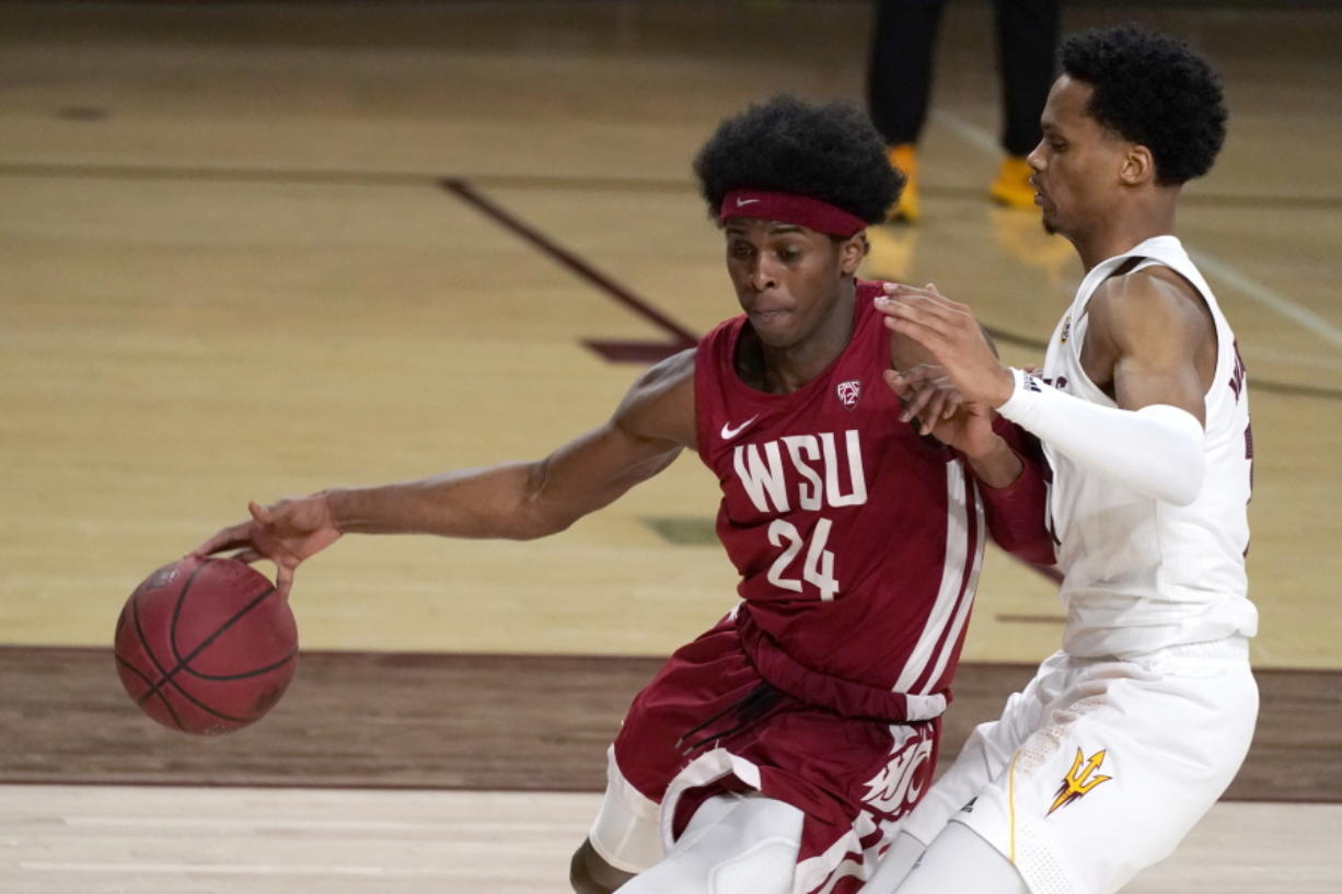 Washington State guard Noah Williams (24) drives past Arizona State guard Alonzo Verge Jr. during the second half of an NCAA college basketball game Saturday, Feb. 27, 2021, in Tempe, Ariz.