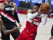 Washington Wizards guard Russell Westbrook looks to pass the ball during the first half of the team's NBA basketball game against the Portland Trail Blazers in Portland, Ore., Saturday, Feb. 20, 2021.