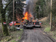Crews from Clark-Cowlitz Fire Rescue faced a challenge Monday when a house down a steep, muddy road near the Lewis River caught fire. The home ended up being a total loss.