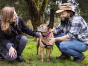 Chloe Wheeler, left, and Jon-Erik Hegstad love on their dog, Shirley, in their backyard on Feb. 5. The Longview couple recently reunited with Shirley after she went missing 15 months ago.