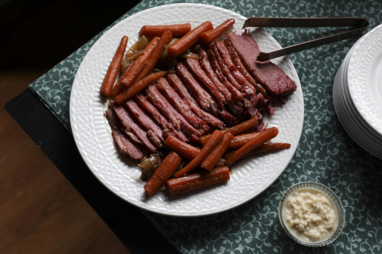 Baked corned beef with caramelized onions and carrots, prepared by Shannon Kinsella.