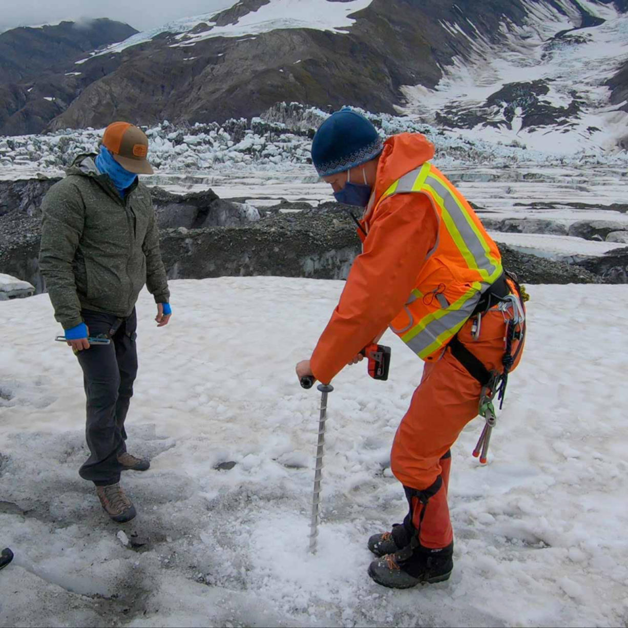 Thomas Otheim, left, a lab technician at Boise State University, and Tim Bartholomaus, a University of Idaho glaciologist, perform research on the Turner Glacier in Alaska.