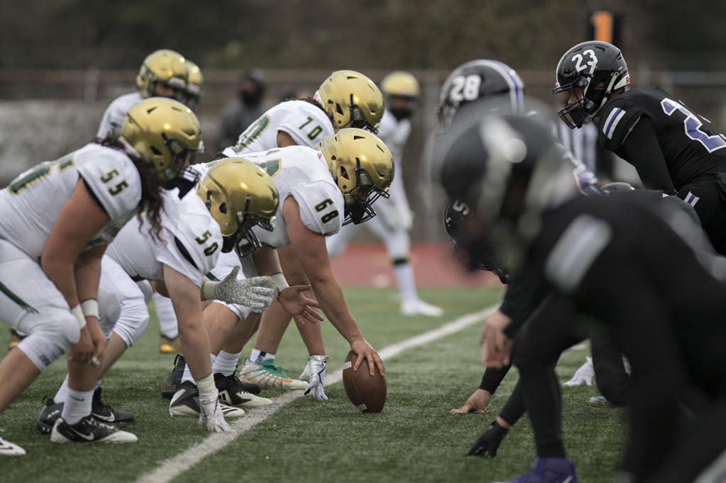 Evergreen players face off against Heritage defenders in the second quarter at McKenzie Stadium on Friday afternoon, March 5, 2021.