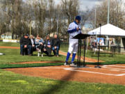 Clark College baseball coach Mark Magdaleno speaks in honor of former pitcher Grant Fisher on Saturday at Walker Stadium in Portland. Behind Magdaleno is Fisher's family, including wife Caitlin and daughter Ellagrace. Fisher was killed on Jan. 29 when his vehicle was hit by an allegedly impaired driver.