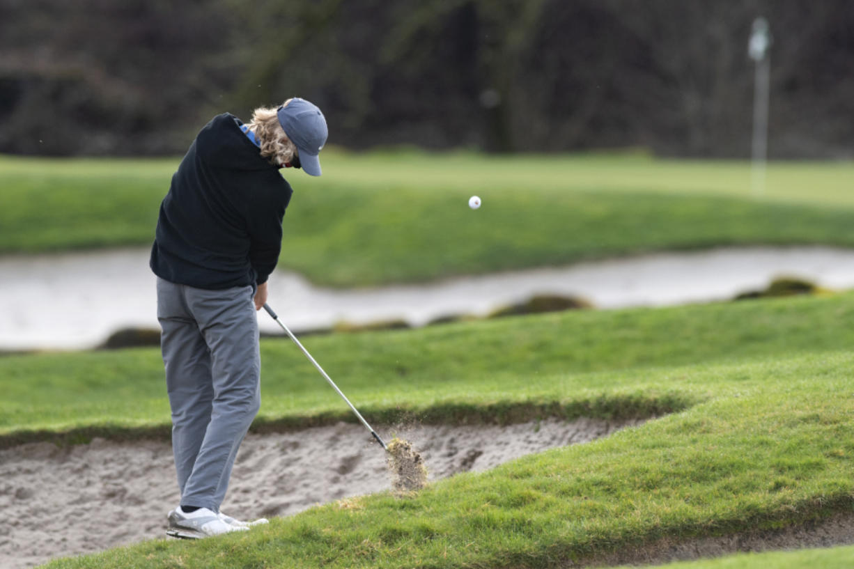 Camas sophomore Eli Huntington hits an approach shot from a tough lie on the fourth hole on Wednesday, February 3, 2021 at Camas Meadows Golf Course.