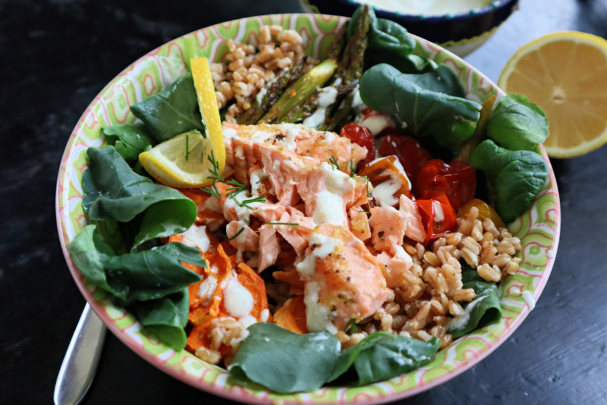 A grain bowl with roasted veggies and lemon-garlic salmon is a great way to kick off fish Fridays for Lent.