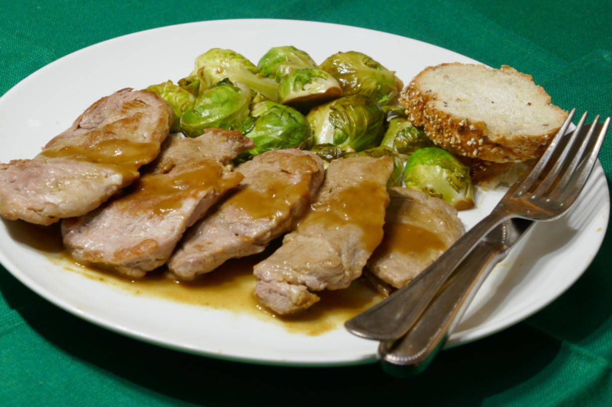 Whiskey Mustard-Crusted Pork with Balsamic Glazed Brussels Sprouts.
