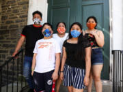 Carmela Apolonio Hernandez, center, is pictured with her four children on the steps of the Germantown Mennonite Church in Pennsylvania, where the family has lived in sanctuary to avoid deportation.