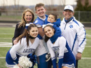 The Lambert family poses for a picture following a football game at Woodland High School. Pictured in back row, from left, are Kerry, Tom, Scotty and John. In front are Lynda and Mary. The Lambert family has always revolved around La Center football, where John has coached for 22 years.