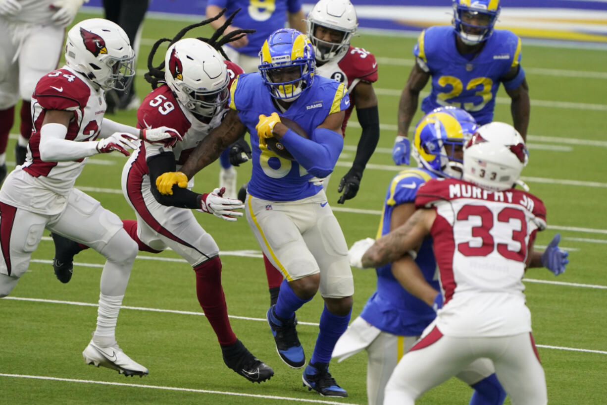 Tight end Gerald Everett, middle, announced on Wednesday, March 17, 2021, that he will sign a one-year deal with the Seattle Seahawks. Everett had a career-high 41 receptions for 417 yards this past season with the Los Angeles Rams. (AP Photo/Jae C.