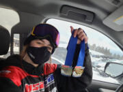 Zoe Smith of Camas holds medals she won on March 7 at a United States of America Snowboard and Freeski Association slopestyle  competition at Timberline on Mount Hood.
