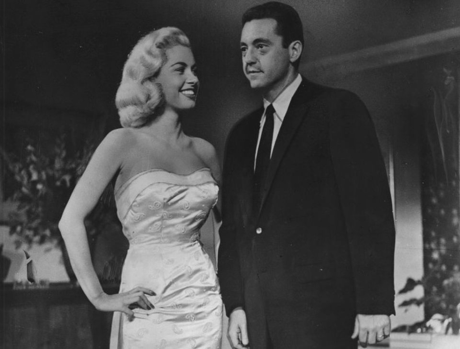 """Jeanne Carmen and Edward Binns in a scene from """"Portland Expose."""""""