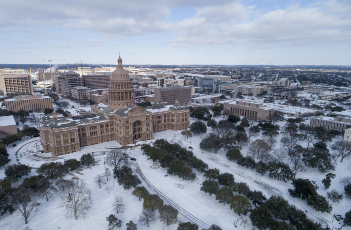 The Texas Capitol grounds are covered in snow on Monday, Feb. 15, 2021, in Austin, Texas.