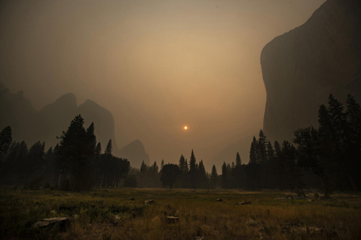 Thick smoke from multiple forest fires shrouds iconic El Capitan, right, and the granite walls of Yosemite Valley on Sept. 12 in Yosemite National Park, Calif.