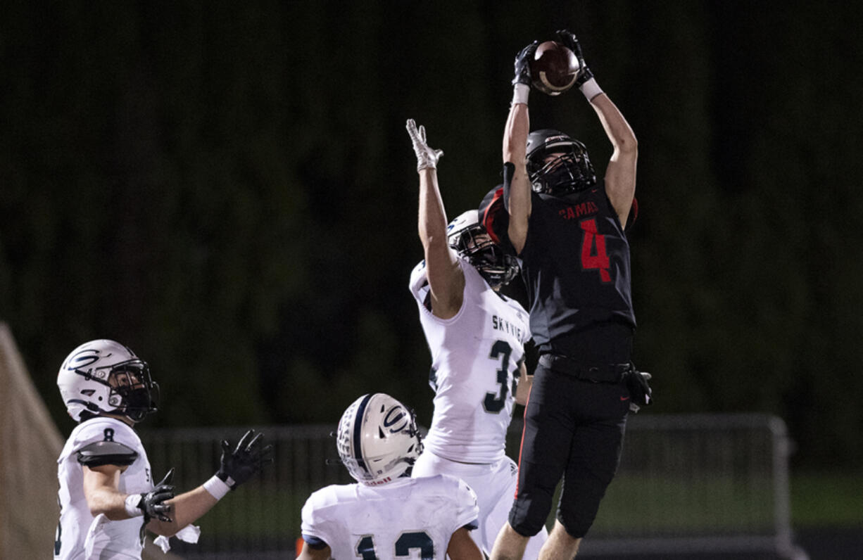 Camas' Andrew Caroussos outleaps Skyview's Brenner Tobiasson for a 35-yard fourth-down completion in the fourth quarter of the Papermakers' 38-31 victory on Tuesday at Doc Harris Stadium. The catch set up Camas' game-tying field goal when time expired.